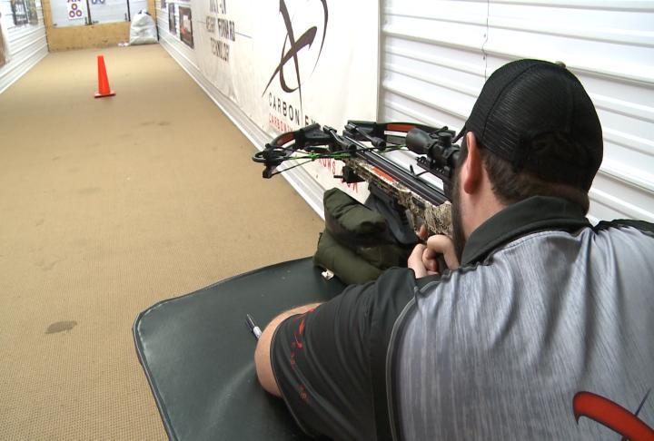 An employee shooting a crossbow