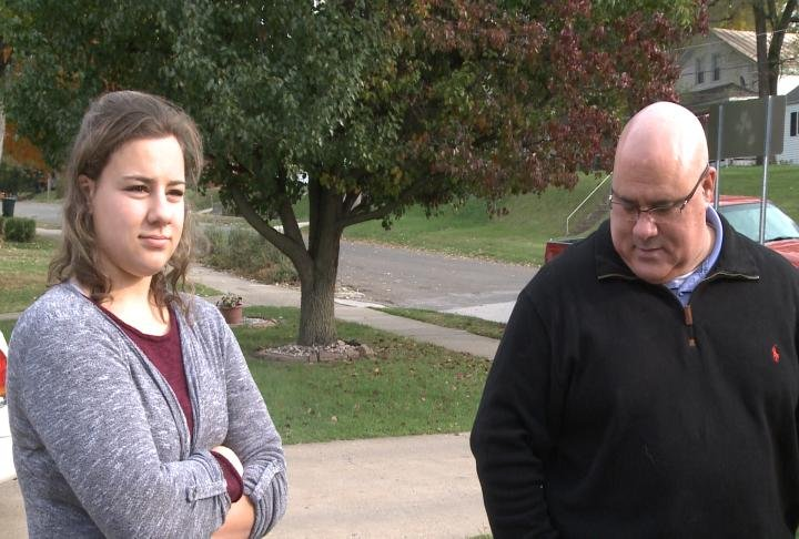 Former Chief Steve Patterson and his daughter stand next to each other.