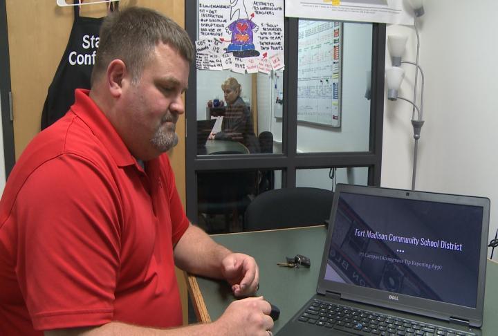 Associate Principal Lamb giving presentation about the app.