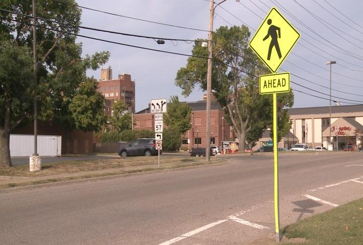 A sign marks where people cross near hotels in downtown Quincy.