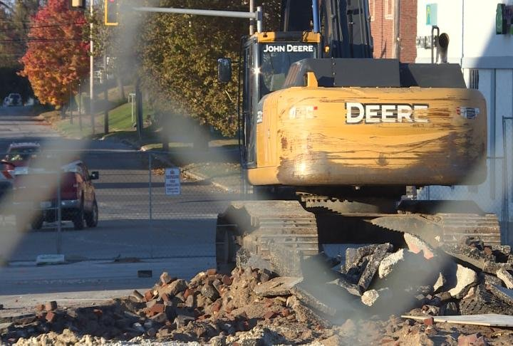 Construction equipment sits where part of 6th street has been torn out.
