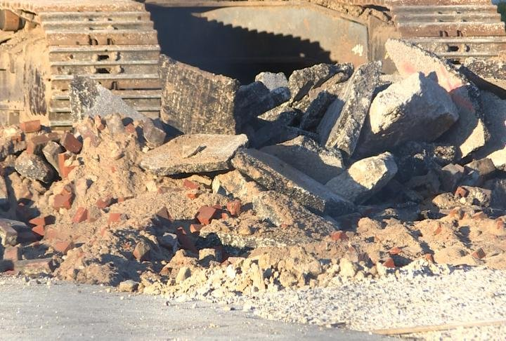 Rubble lays around construction equipment on the new Adams County Jail site.