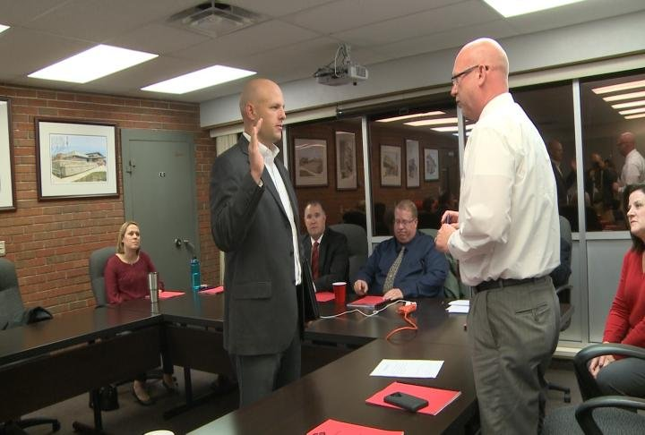 Rapp is sworn in as newly appointed board member.