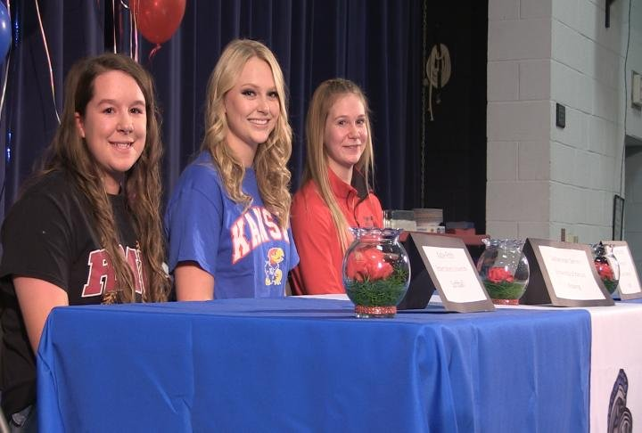 Three Bushnell-Prairie City student athletes signed on the dotted line during a Thursday afternoon ceremony.