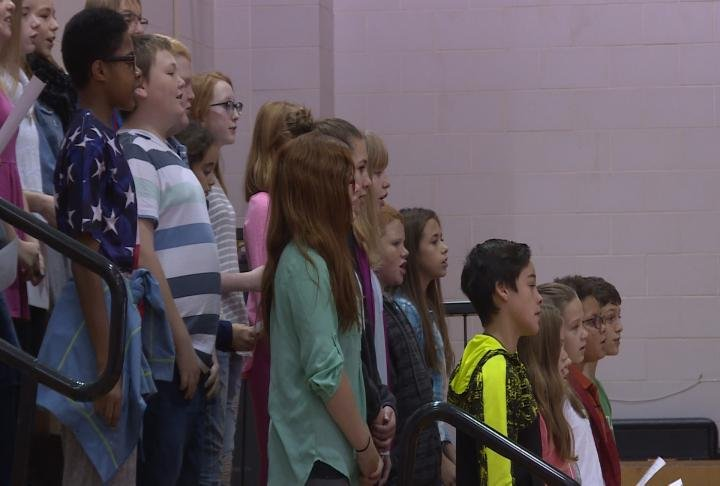 Students sang a tribute to the veterans.