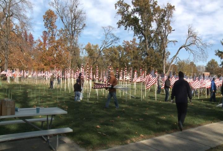 The Quincy Exchange Club set up Flags on Friday at Madison Park.