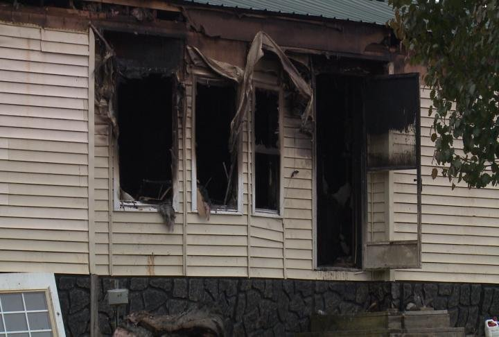 The Monroe County Coroner said the home was fully engulfed in flames.