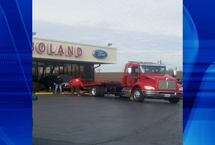 Towing crews helped move car from the building. (Photo Courtesy of Darren Johnson)