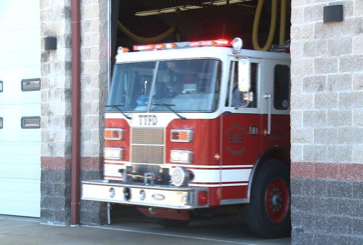 Fire truck leaving its station to go to an incident.