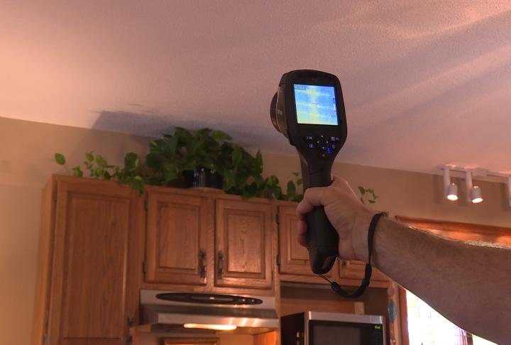 Ameren official uses a device when testing a Quincy home.
