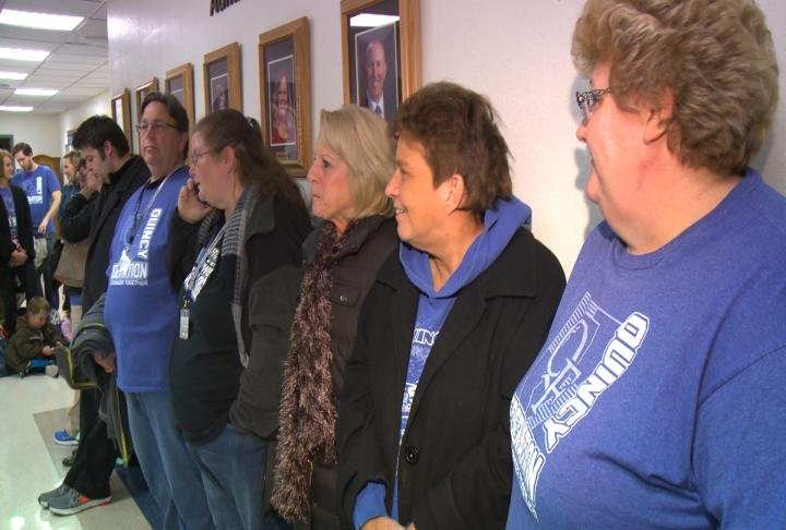 "Union members chanted ""fair compensation"" as district officials walked into the meeting Monday night."