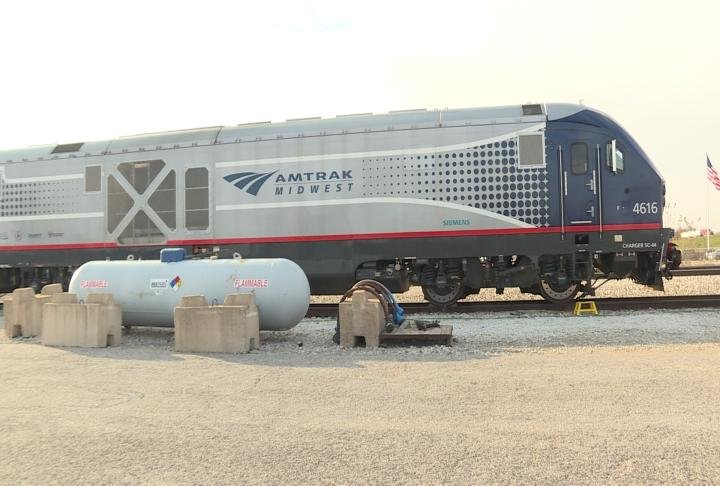 Amtrak's Charger locomotive parked on railroad tracks.