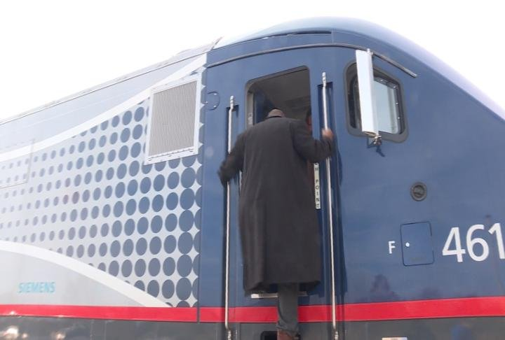 Viewer climbs out of the Charger conductor cabin.