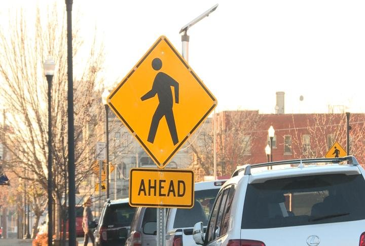 Pedestrian crossing sign displayed along Hampshire Street.