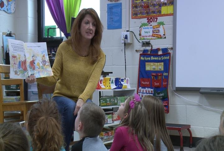 Schutte reading to her students