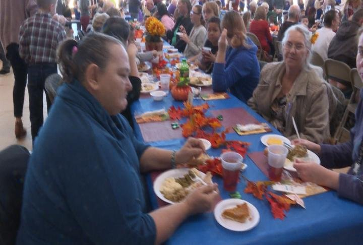 Residents eat a Thanksgiving Meal at the Kroc Center.
