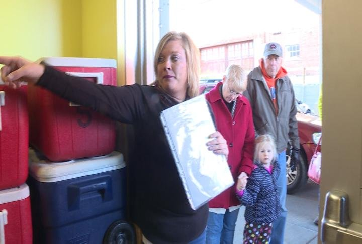 Meals on Wheels officials explain the process for delivering food.