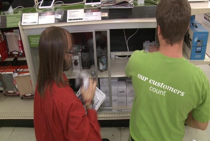 Shopko employees restock shelves after only two hours of being open.