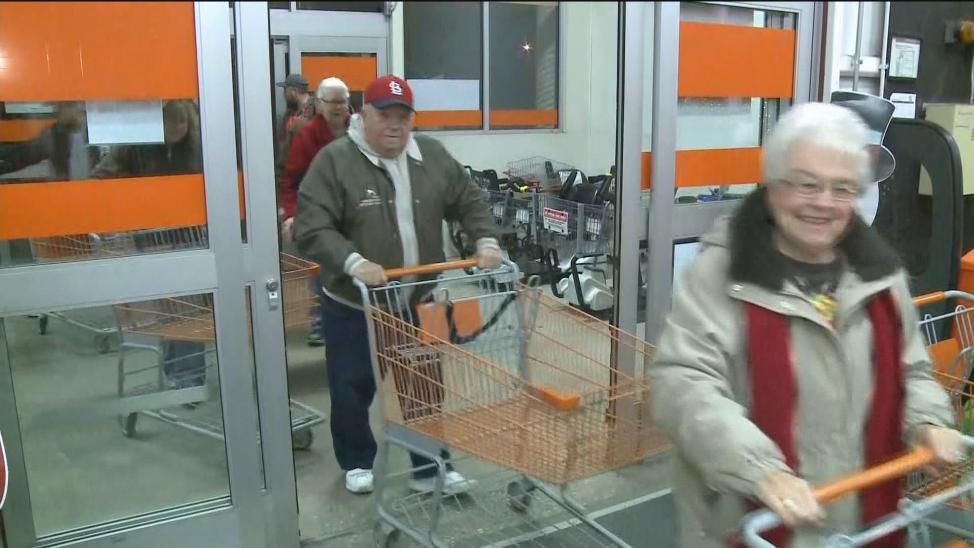 Shoppers race through doors at Home Depot
