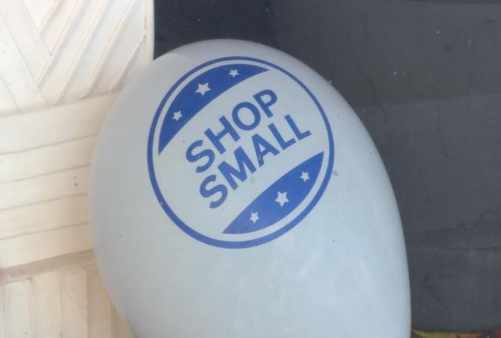 A Small Business Saturday balloon displayed in a shop window.