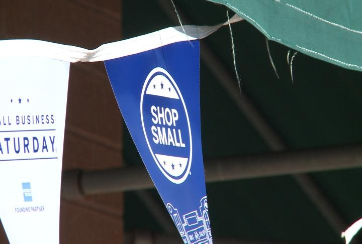 "Banners displayed the message ""shop small""."
