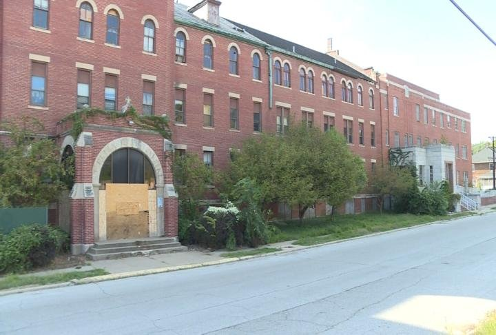 The front doors to the vacant hospital are boarded up.