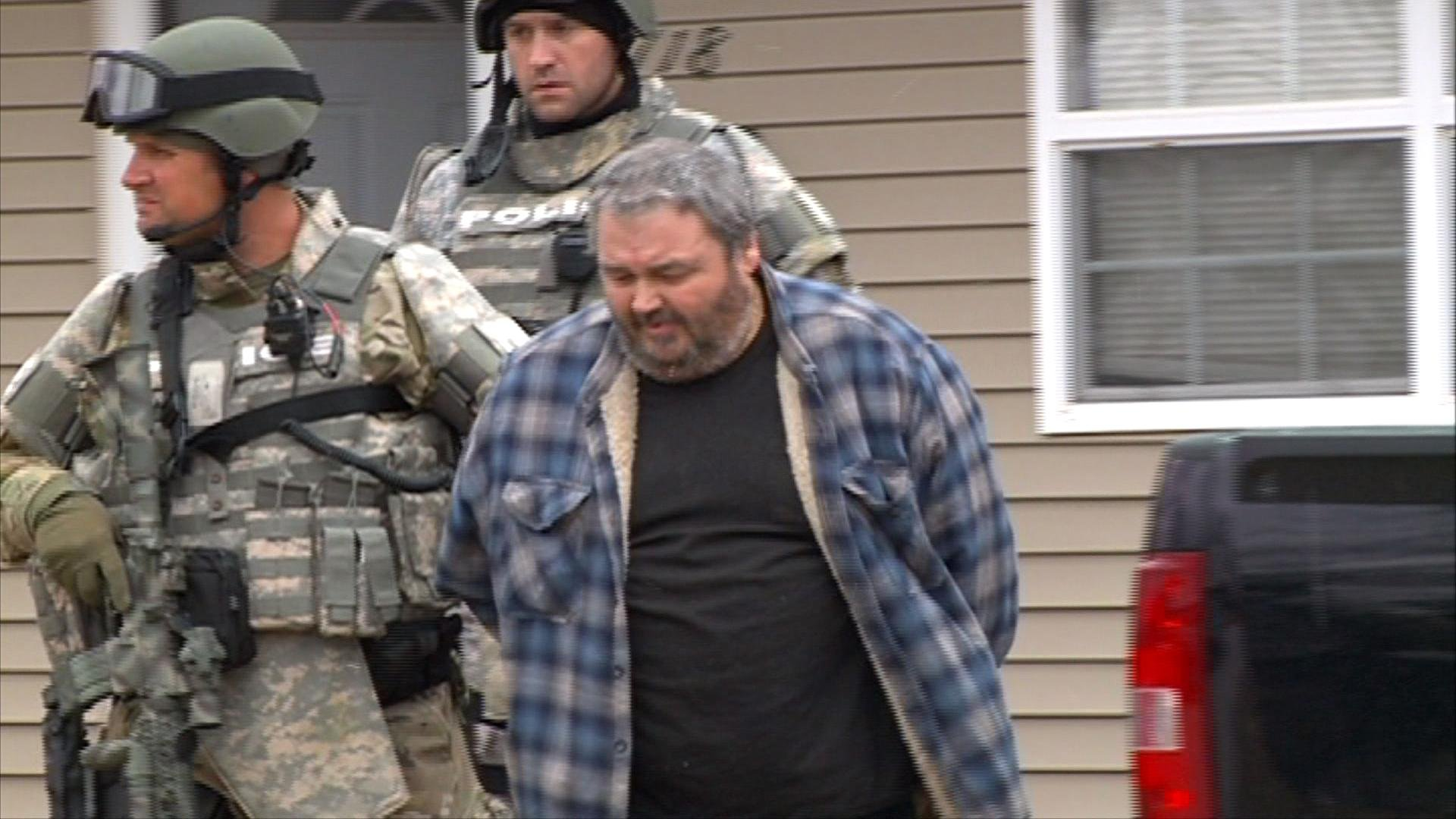 Quincy police arrest Donald Pruett at his home in 2013 following a 21-hour long standoff. Illinois Attorney General Lisa Madigan said Monday that a ruling declared Pruett a sexually violent person.