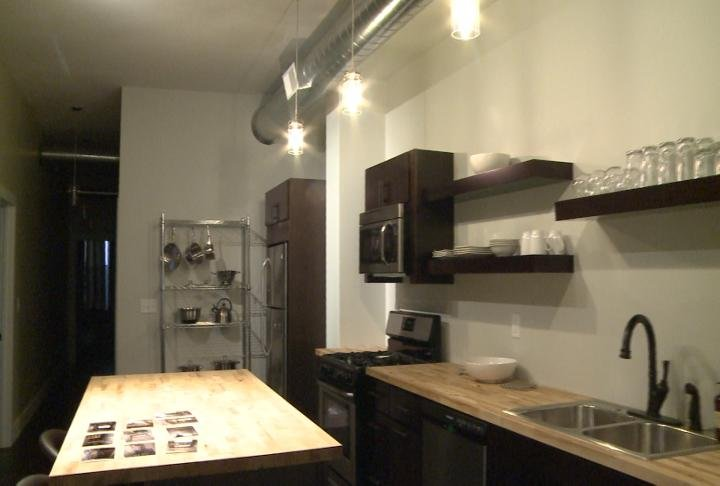 Kitchen area inside a newly renovated apartment in downtown Quincy.