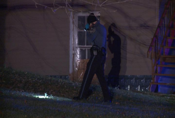 Officer looks for evidence at the crime scene.