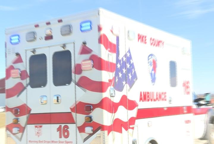 An ambulance leaving the station