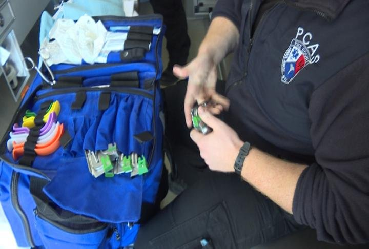 A paramedic checking supplies in the ambulance
