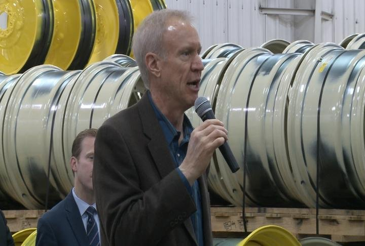 Illinois Governor Bruce Rauner talks during a stop in Quincy.