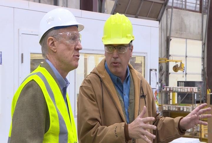 Bruce Rauner gets a tour of a local facility during a recent stop in Quincy.