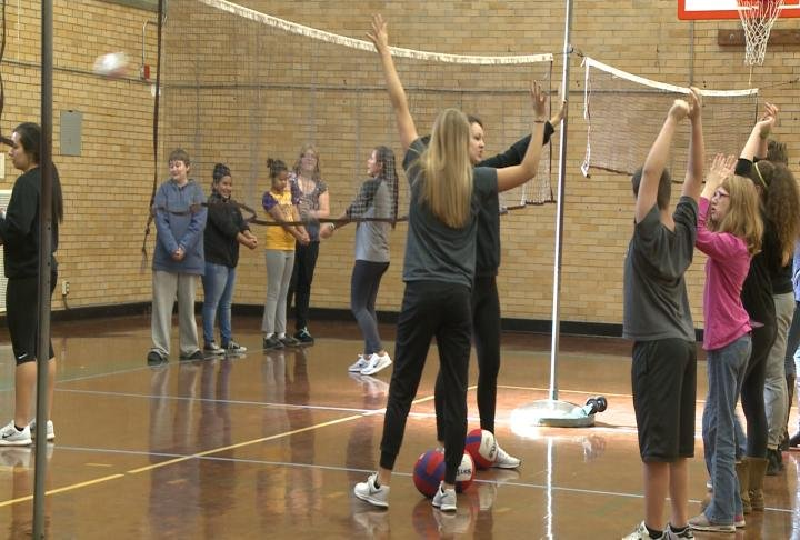 QU Women's Volleyball team visited Quincy Junior High School on Friday.