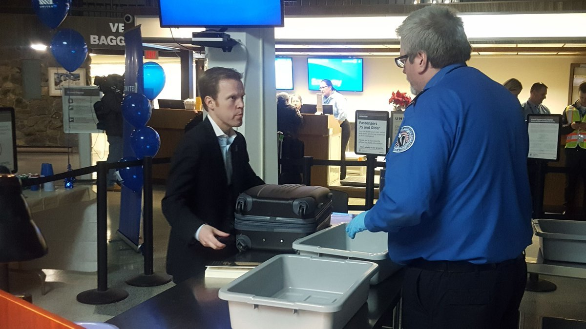 Mayor Kyle Moore goes through security ahead of the first jet service flight.