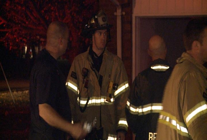 Firefighters say heating light is cause of smoke inside home.