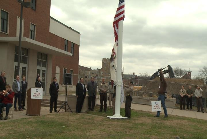 Raising of the flag at the Adams County Courthouse on Monday.
