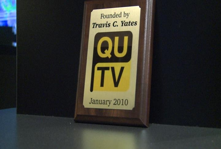 A plaque marking the start of QUTV in studio.