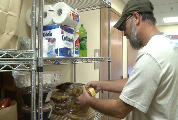 Brokes filling food baskets as part of his volunteer duties.