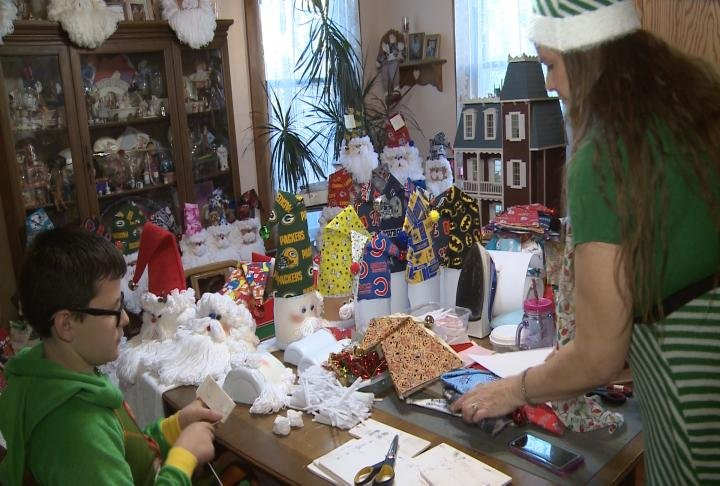 Pamela Neff and her 12-year-old grandson made Santas out of plastic bottles.