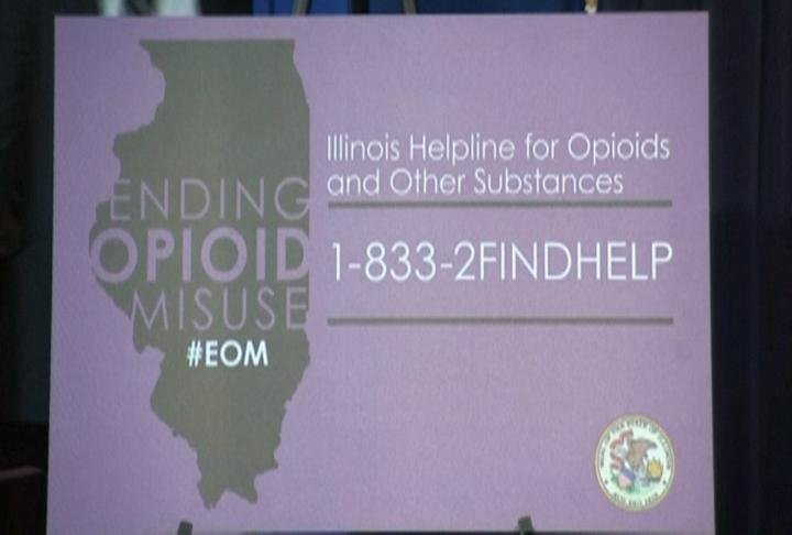 A poster shows off the new opioid crisis line number.