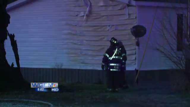 Crews at the scene of the fire. You can see the siding started to melt.