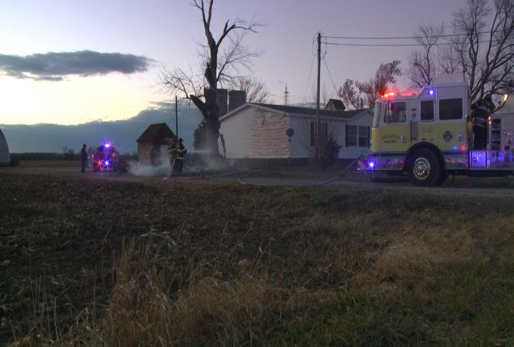 The grass fire spread to the tree next to the home.