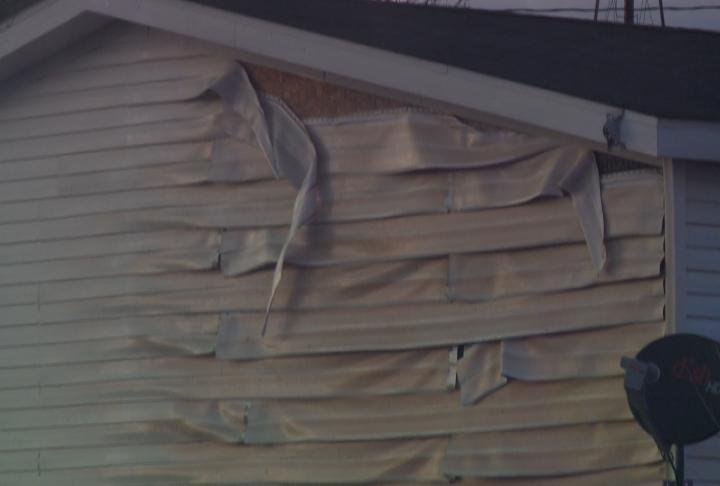 Part of the siding of the home melted from the fire.
