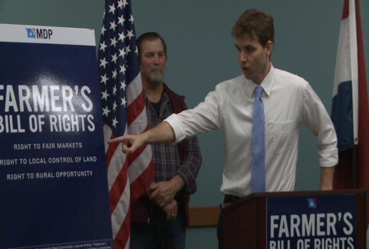 Missouri Democratic Party Chair Stephen Webber pointing out core values in Farmer's Bill of Rights.
