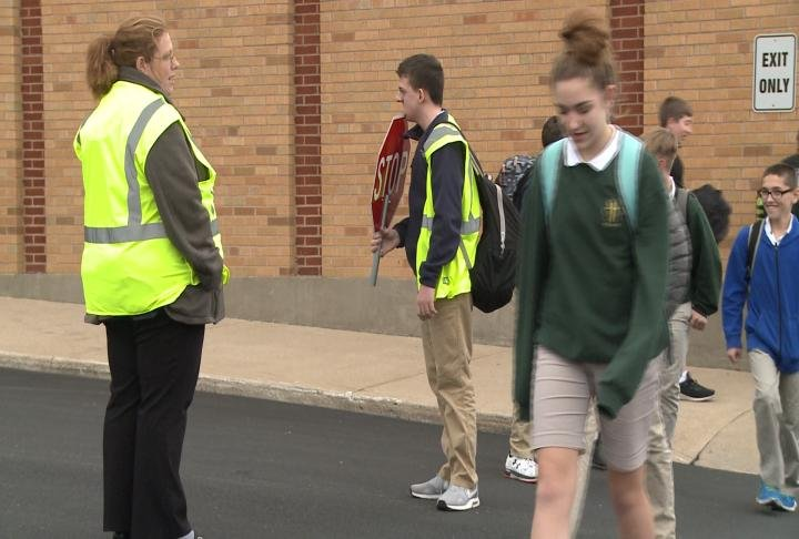 Students at Holy Family have to walk across a busy street to get picked up by their parents.