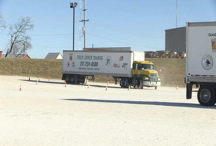 Students practice and train to become truck drivers.