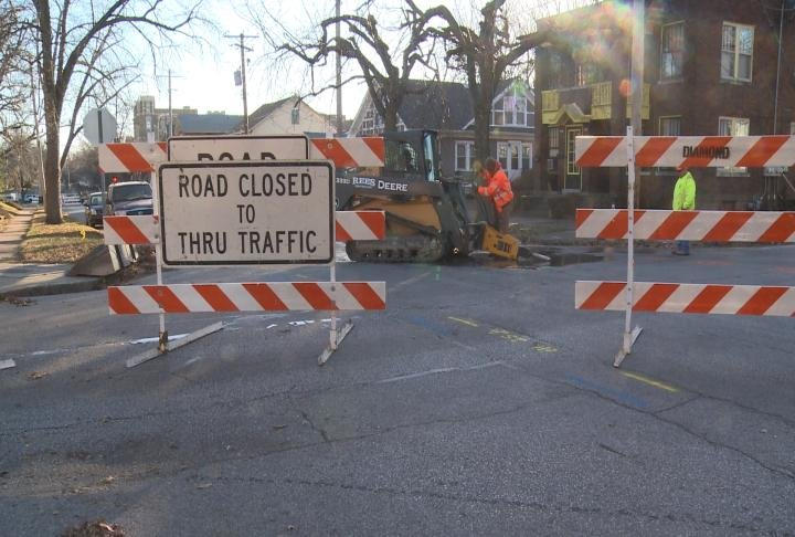 Road closure signs block where crews worked on a water main break.