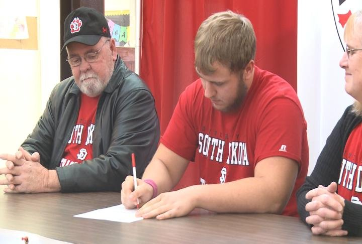 West Hancock's Andy Bird signed on with South Dakota track and field on Wednesday.