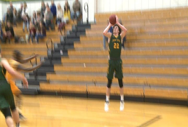 John Wood's Cory Miller Jr. spots up for a three pointer.